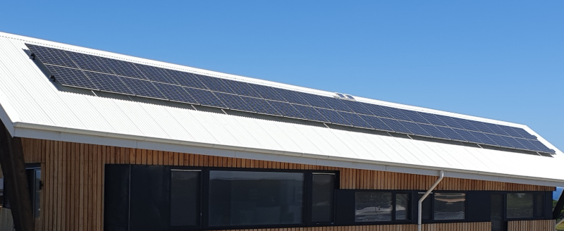 Solar panels on a white roof